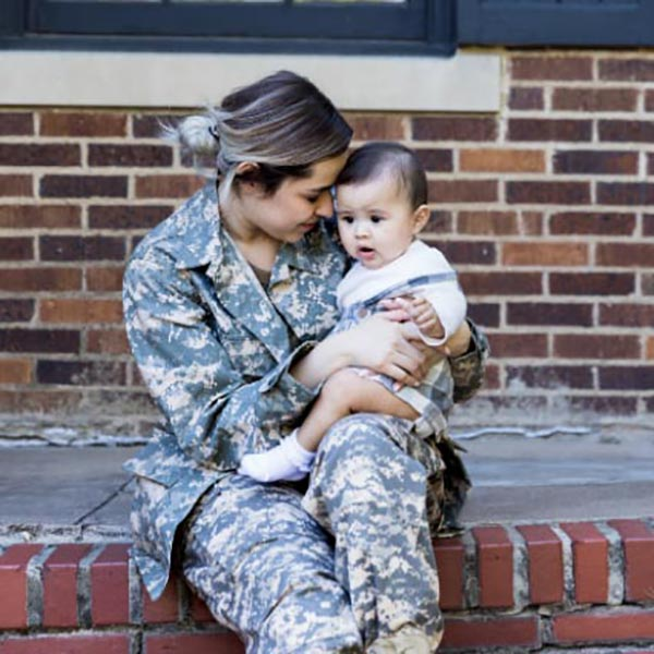 VA Loan image of a soldier and baby